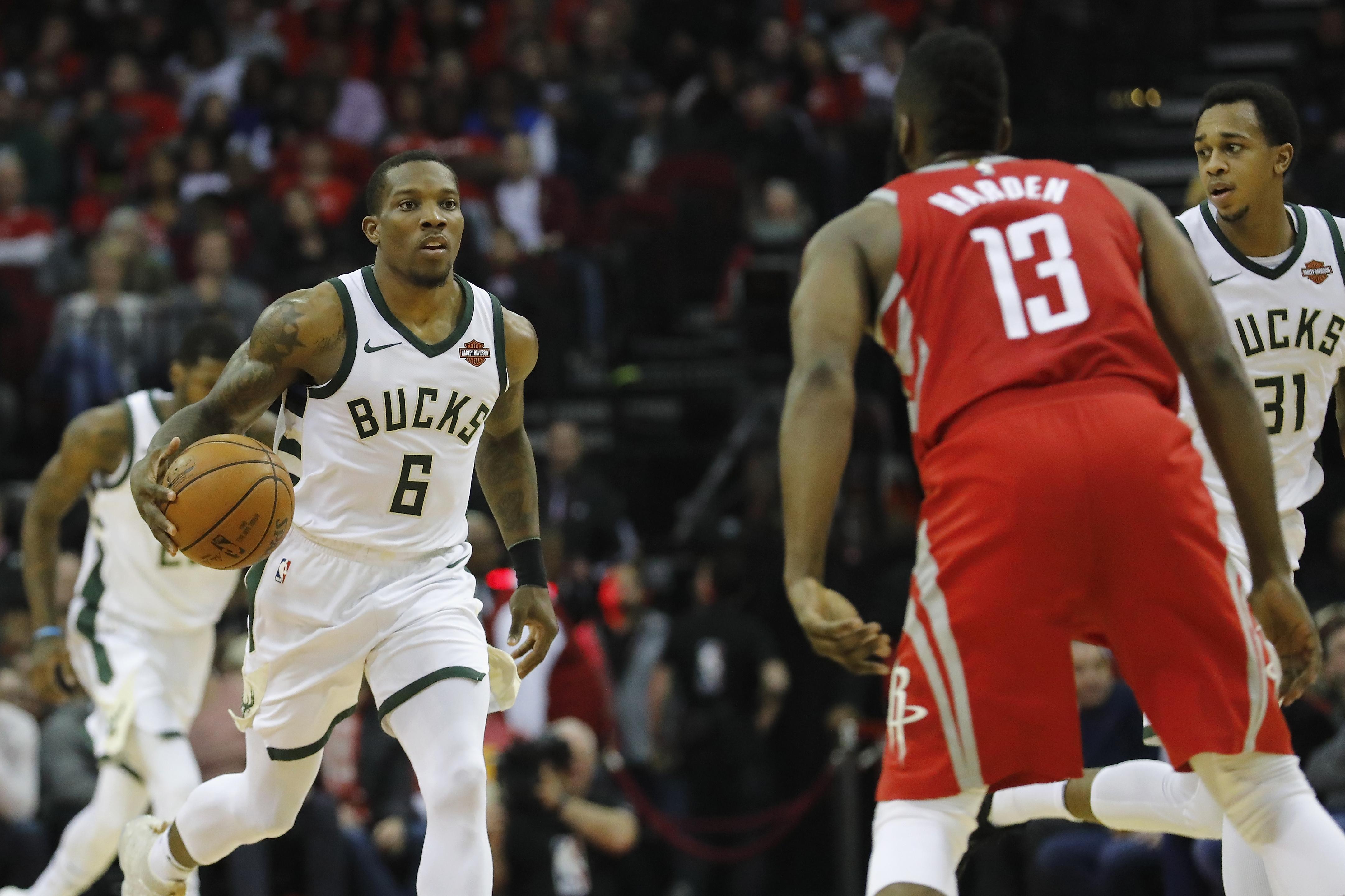 Harden, Paul build huge Rockets lead to hold off Spurs