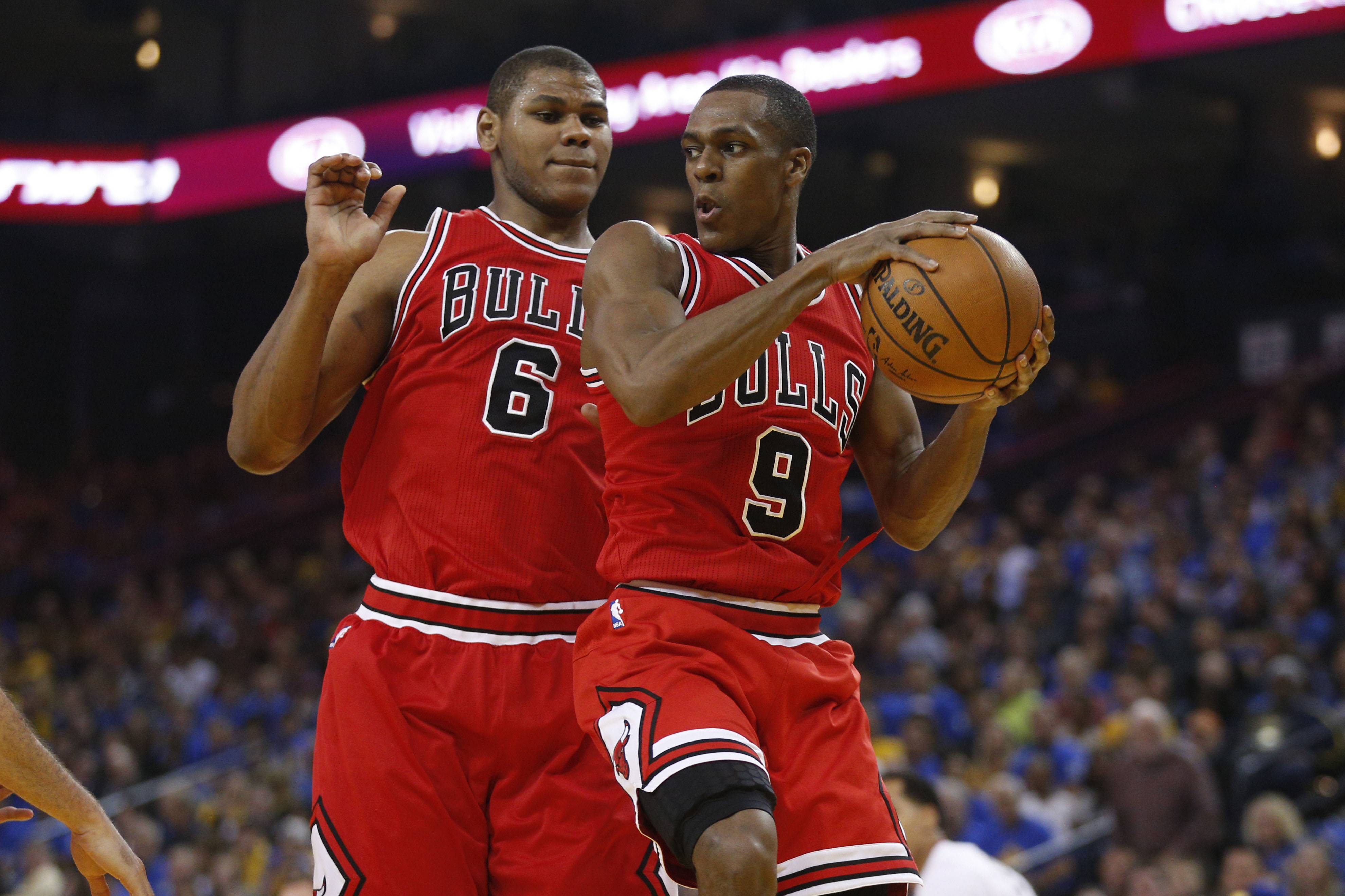 e5cac7ef985c ... USA  Chicago Bulls guard Rajon Rondo (9) holds onto a rebound in front  of forward Cristiano Felicio (6) during action against the Golden State  Warriors ...